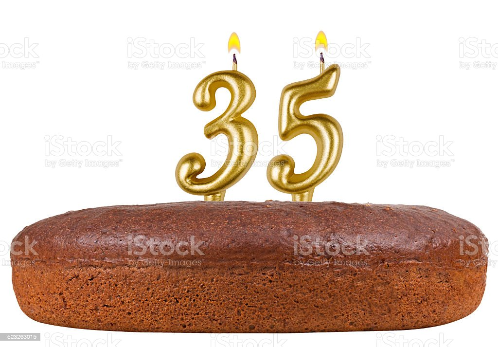 birthday cake candles number 35 isolated stock photo