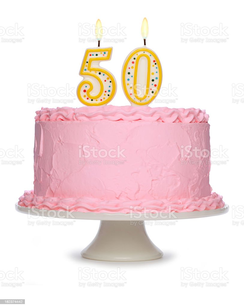 A birthday cake with lit candles set against a pure white background.
