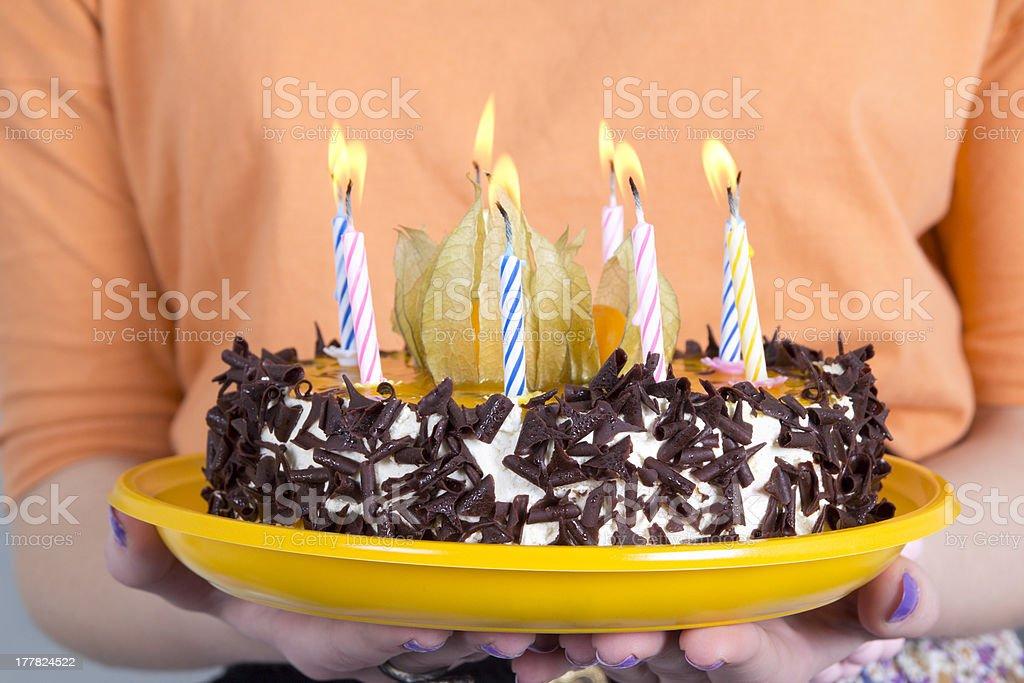 birthday cake in female hands royalty-free stock photo