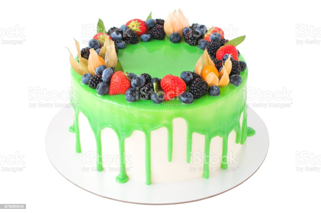 Birthday Cake In Green Glaze Decorated With Strawberries Blueberries