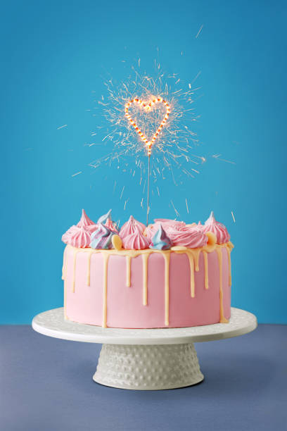 Birthday Cake Isolated On A Blue Background Party Decorated With Candles And Sparkles