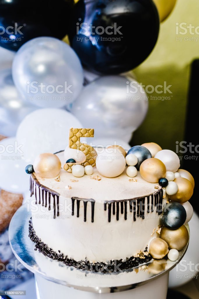 Birthday Cake on a background balloons party decor. Copy space....