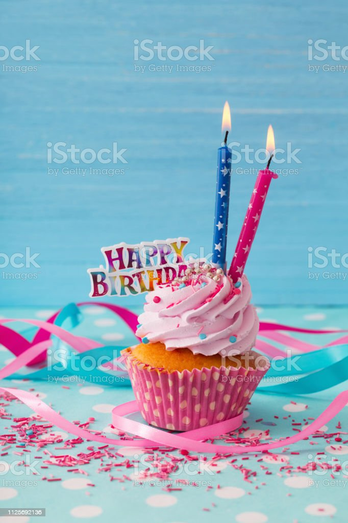 birthday cake on blue wooden background