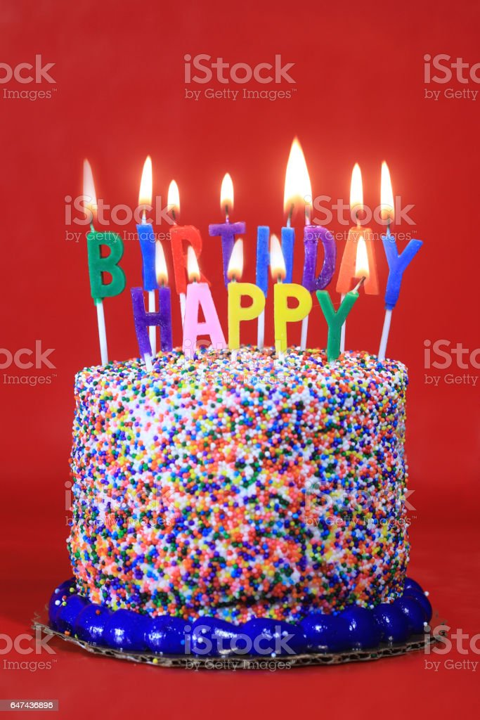 Birthday Cake On Red Background With Burning Candles