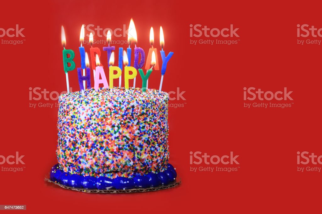 Birthday Cake On Red Background With Burning Candles Royalty Free Stock Photo