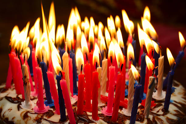 birthday cake birthday cake with the lot of burning candles birthday candle stock pictures, royalty-free photos & images