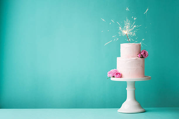Birthday cake Birthday cake with sparkler cakestand stock pictures, royalty-free photos & images