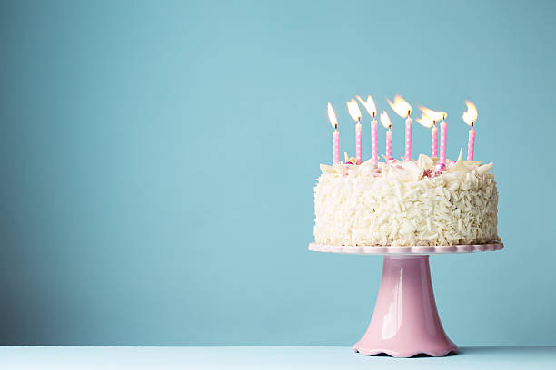 Birthday cake Birthday cake with pink candles cakestand stock pictures, royalty-free photos & images