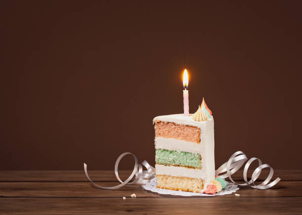 Birthday Cake slice with candle stock photo