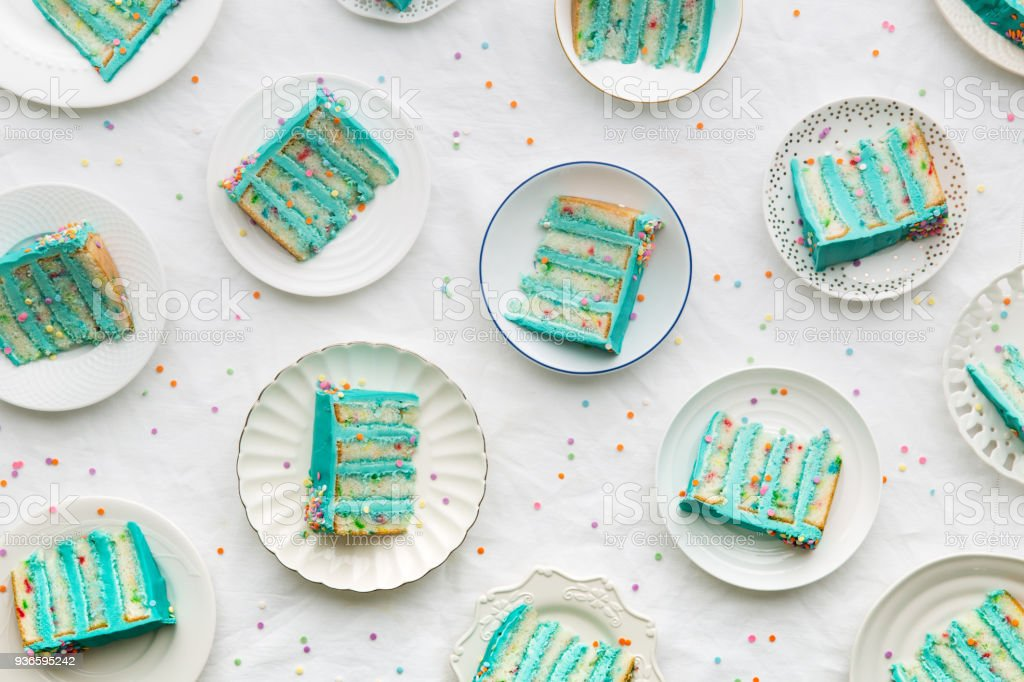 Birthday cake slices from above stock photo