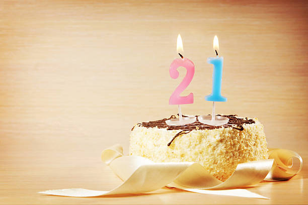 birthday cake with burning candle as a number twenty one - number 21 stock photos and pictures