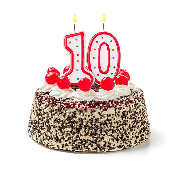 Birthday cake with burning candle number 10 stock photo