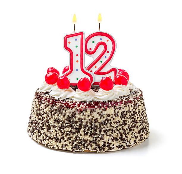 Birthday cake with burning candle number 12 stock photo