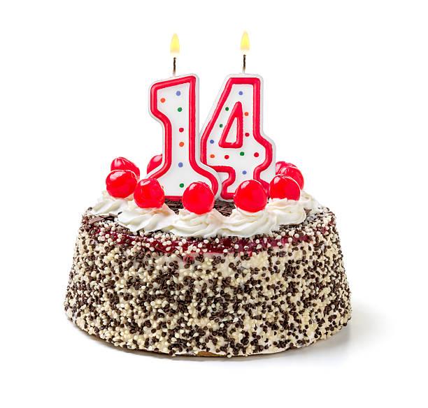 Birthday cake with burning candle number 14 stock photo