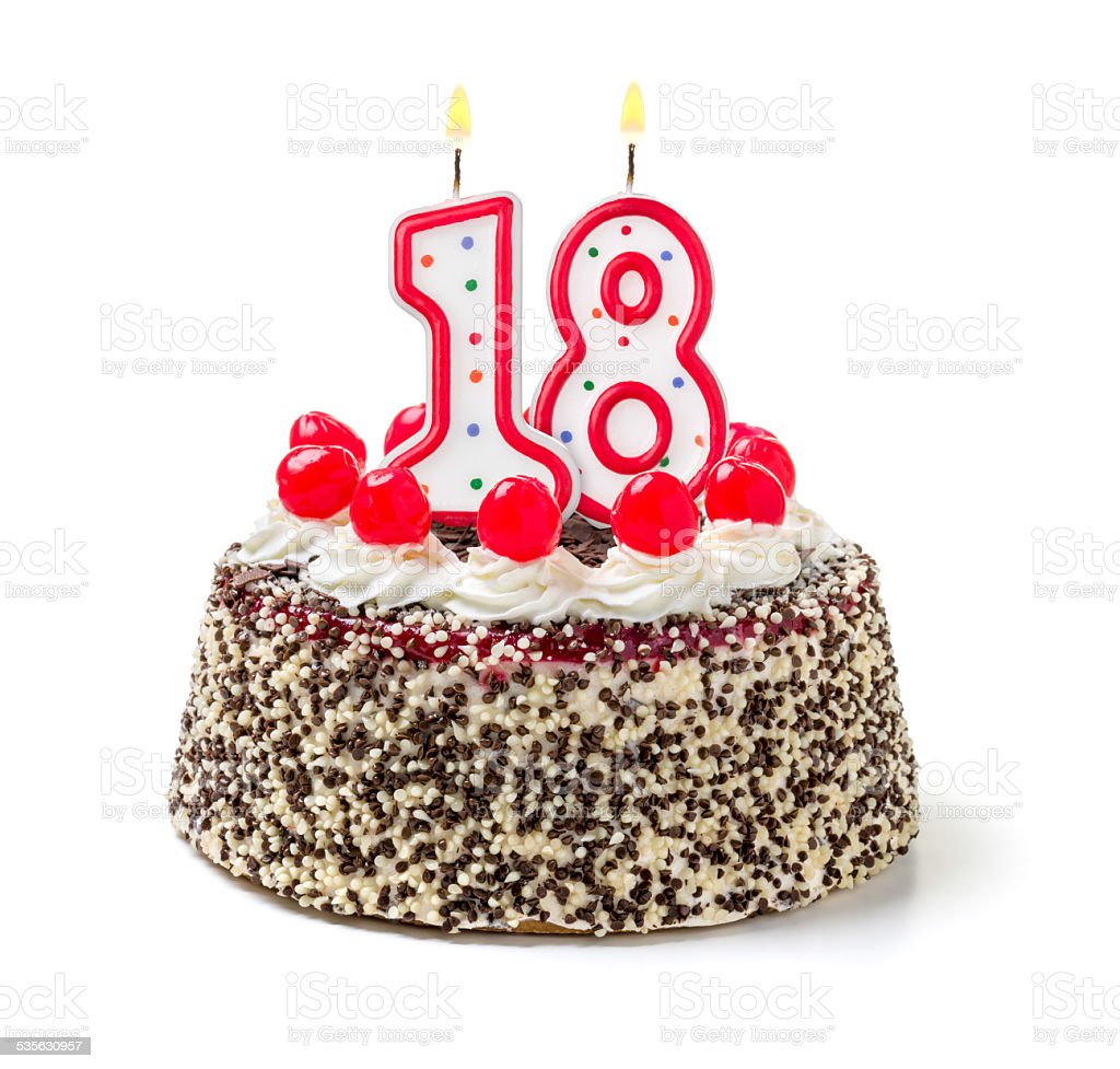 Birthday cake with burning candle number 18 stock photo