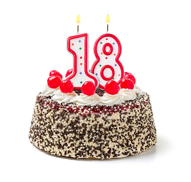 birthday cake with burning candle number 18 - number 18 stock photos and pictures