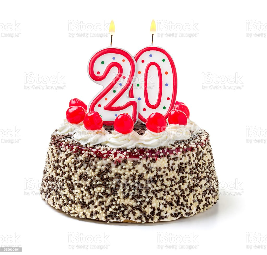 Birthday cake with burning candle number 20 stock photo