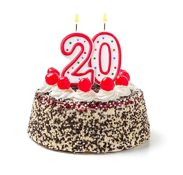 Birthday cake with burning candle number 20 stock photo