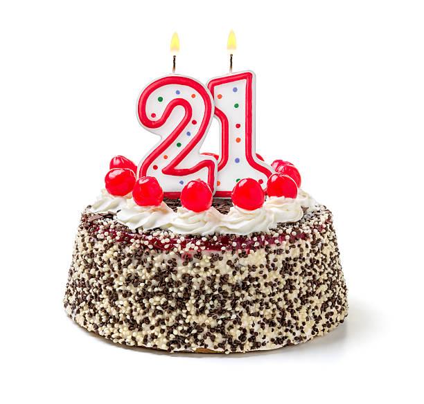 Birthday cake with burning candle number 21 stock photo