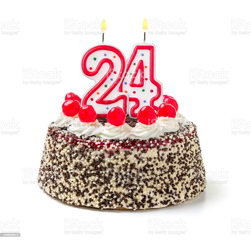 Birthday cake with burning candle number 24 stock photo