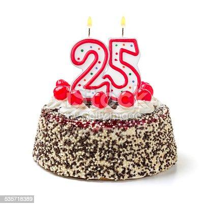 178269167istockphoto Birthday cake with burning candle number 25 535718389