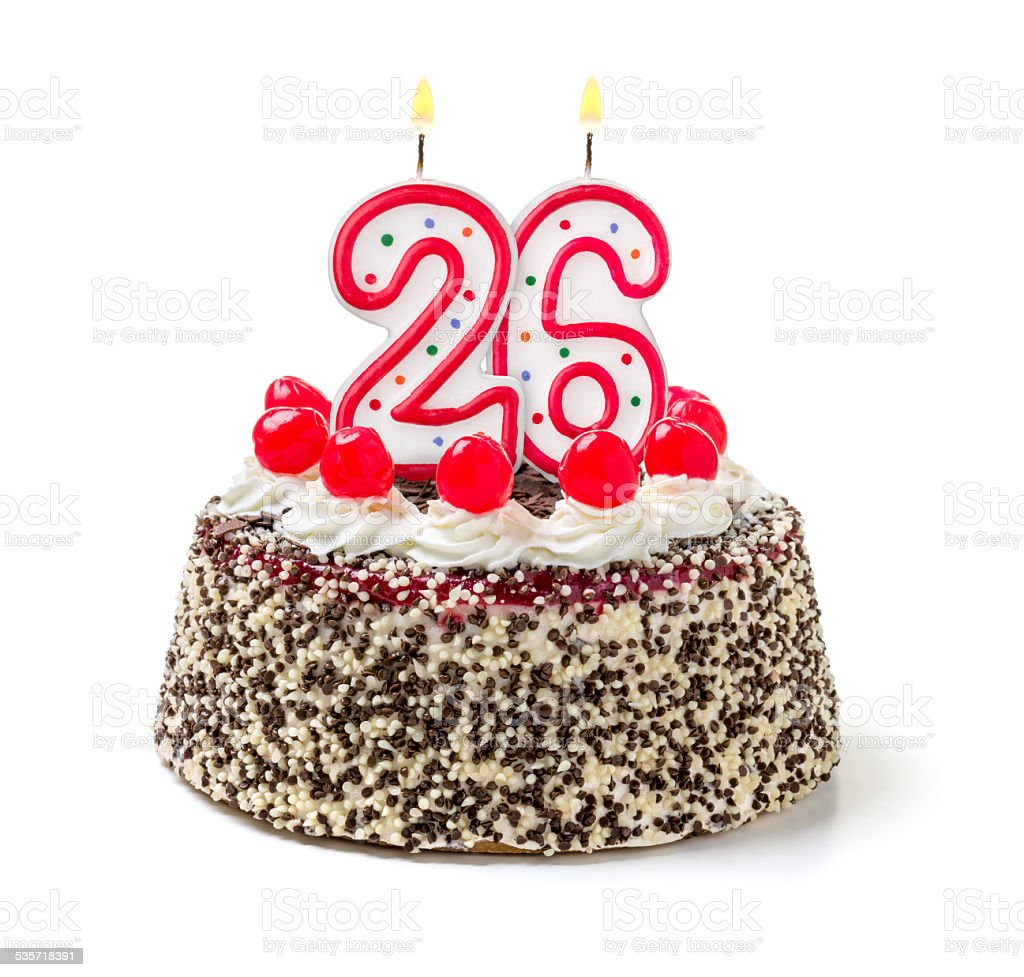 Birthday cake with burning candle number 26 stock photo