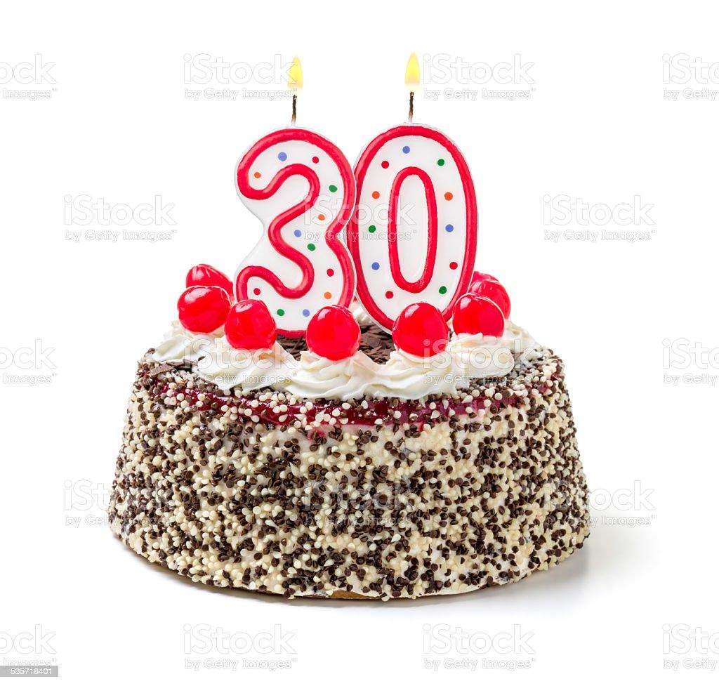 Birthday cake with burning candle number 30 stock photo