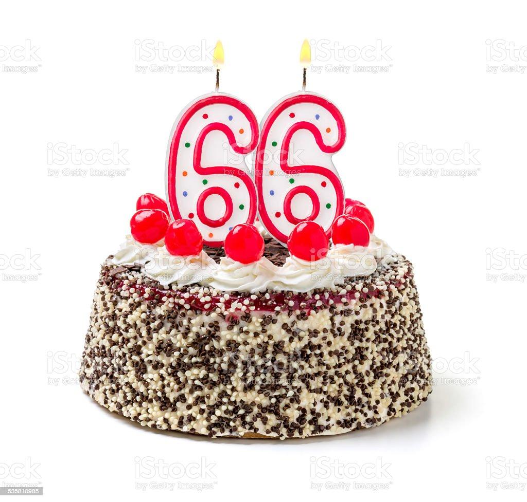 Birthday cake with burning candle number 66 stock photo