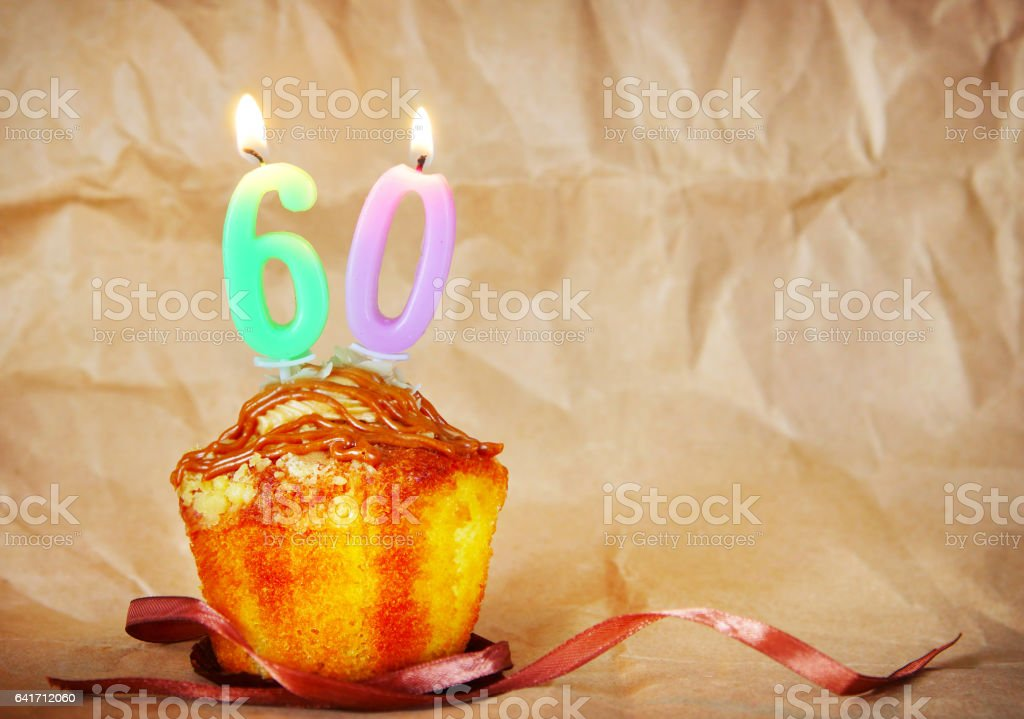 Birthday cake with burning candles as number sixty stock photo