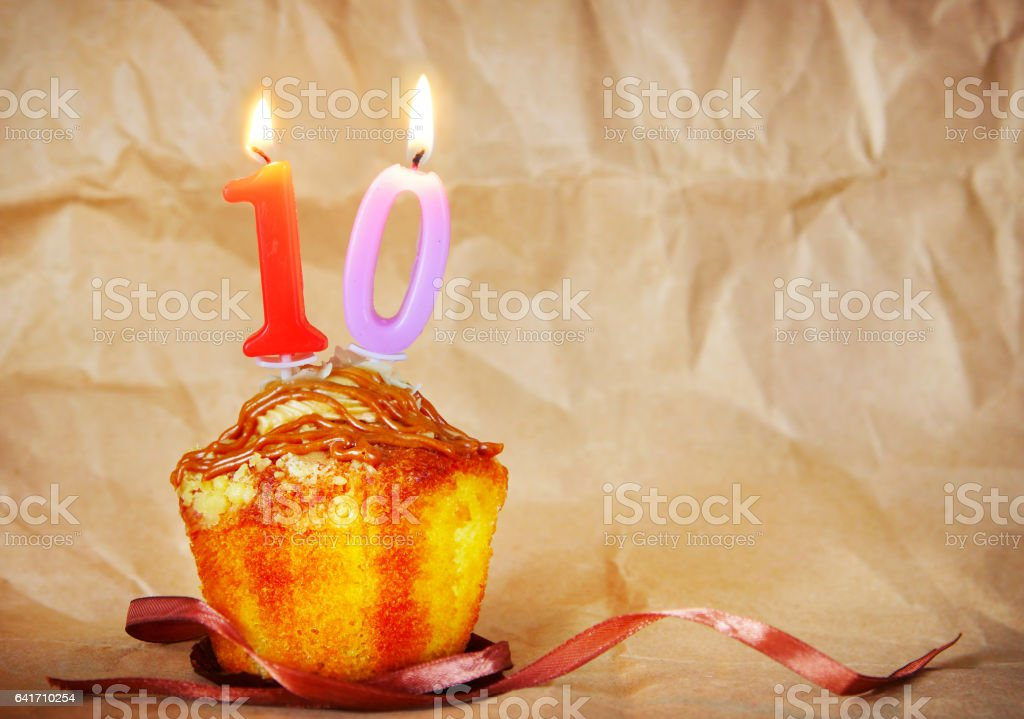 Birthday cake with burning candles as number ten stock photo