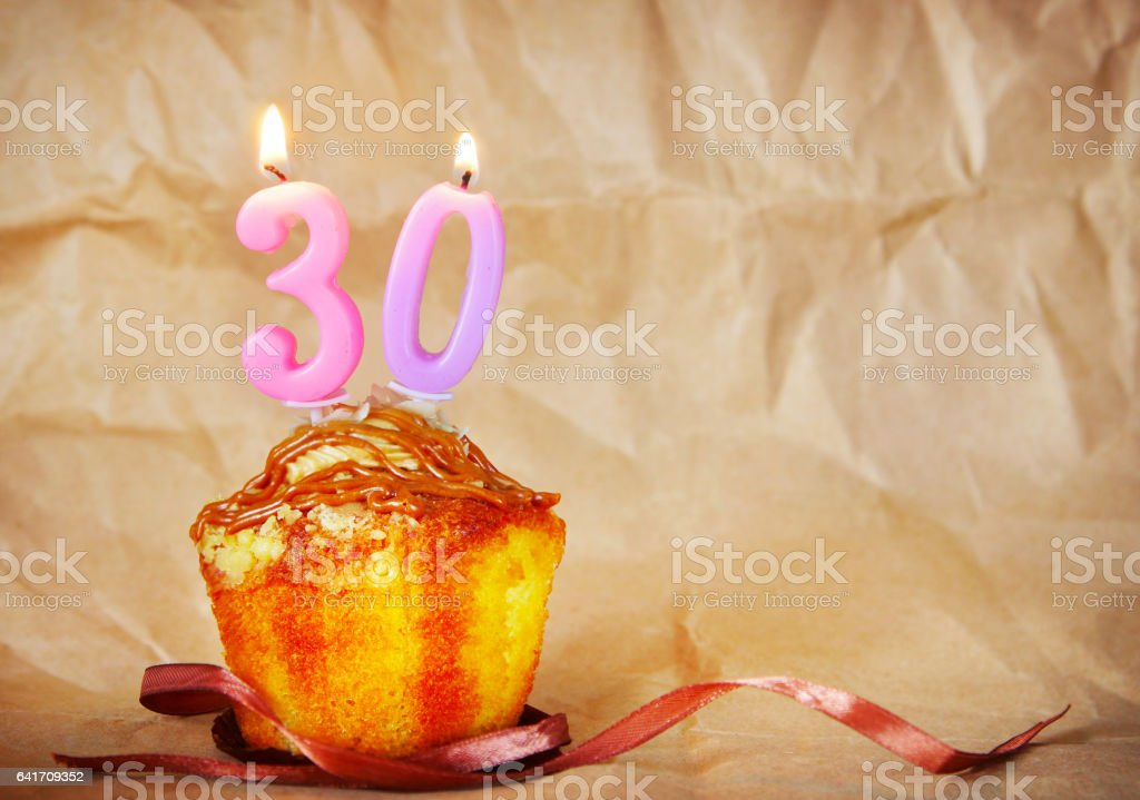 Birthday cake with burning candles as number thirty stock photo