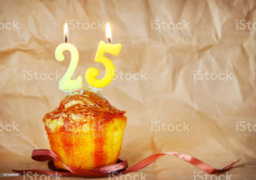 Birthday cake with burning candles as number twenty five stock photo