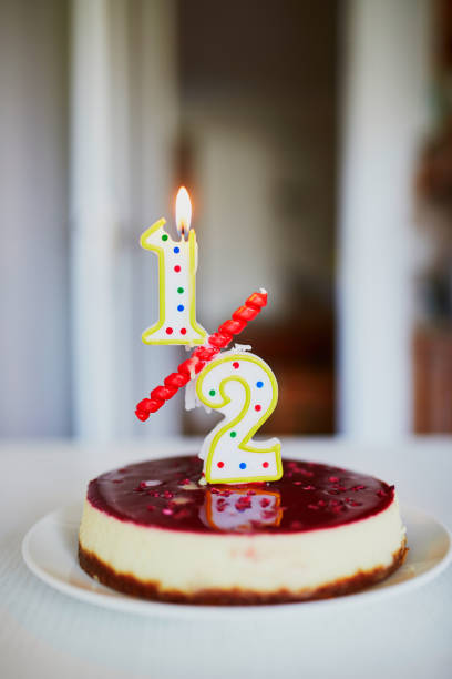Birthday cake with candle on it stock photo