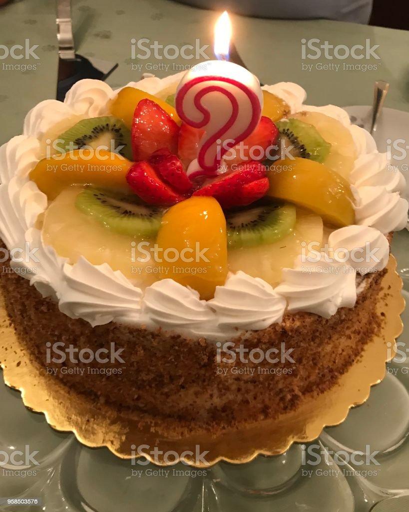 Birthday cake with candle - fotografia de stock