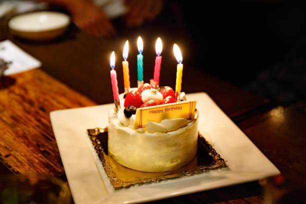 Birthday cake with candlelight stock photo