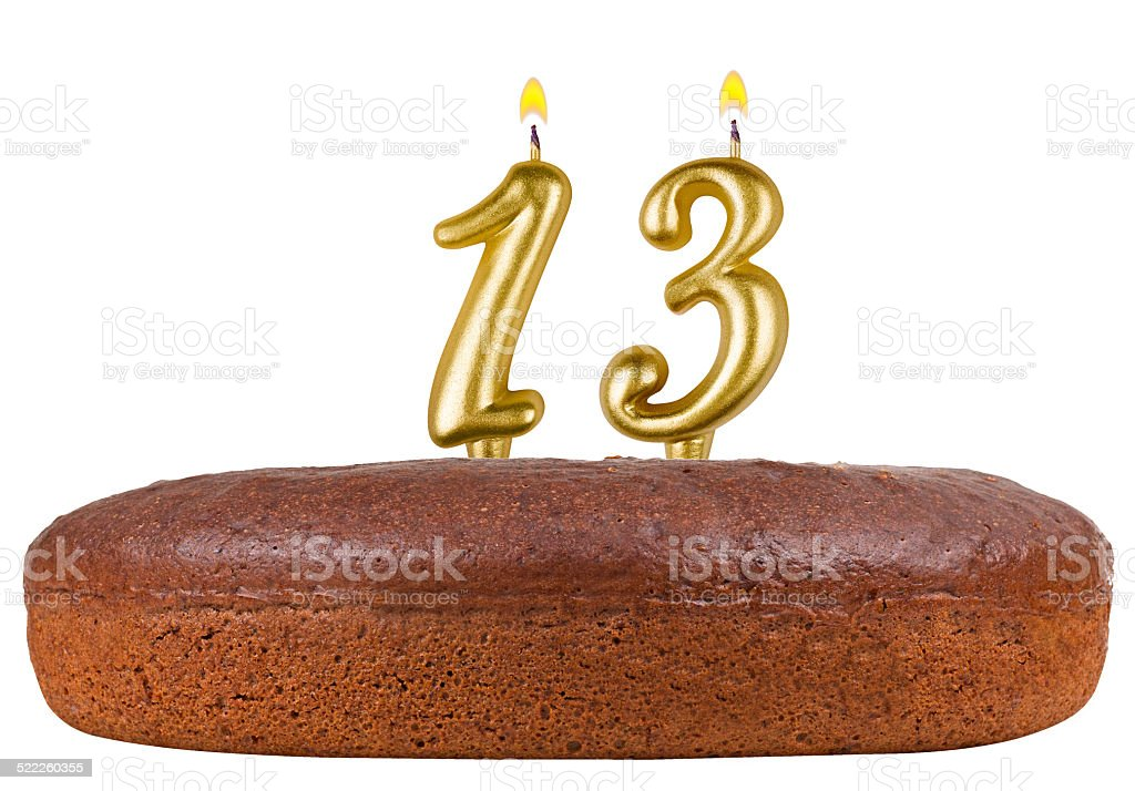 birthday cake with candles number 13 isolated stock photo