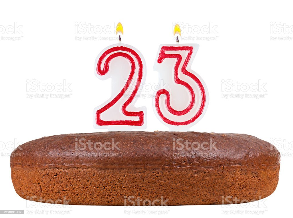 birthday cake with candles number 23 isolated on white stock photo