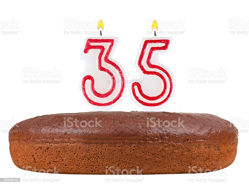 birthday cake with candles number 35 isolated on white stock photo