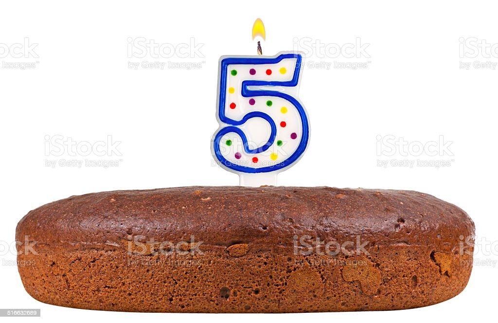 birthday cake with candles number five isolated on white stock photo