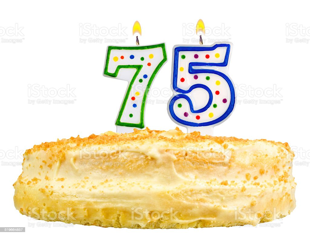birthday cake with candles number seventy five isolated stock photo