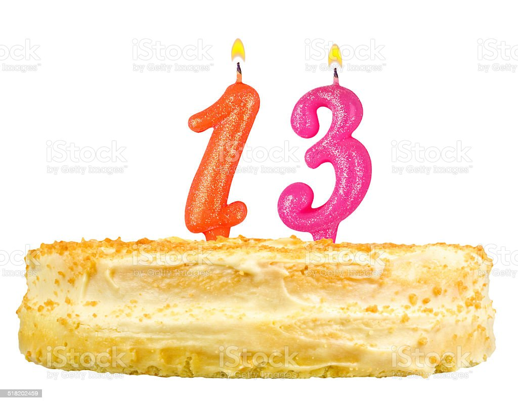 birthday cake with candles number thirteen isolated on white stock photo