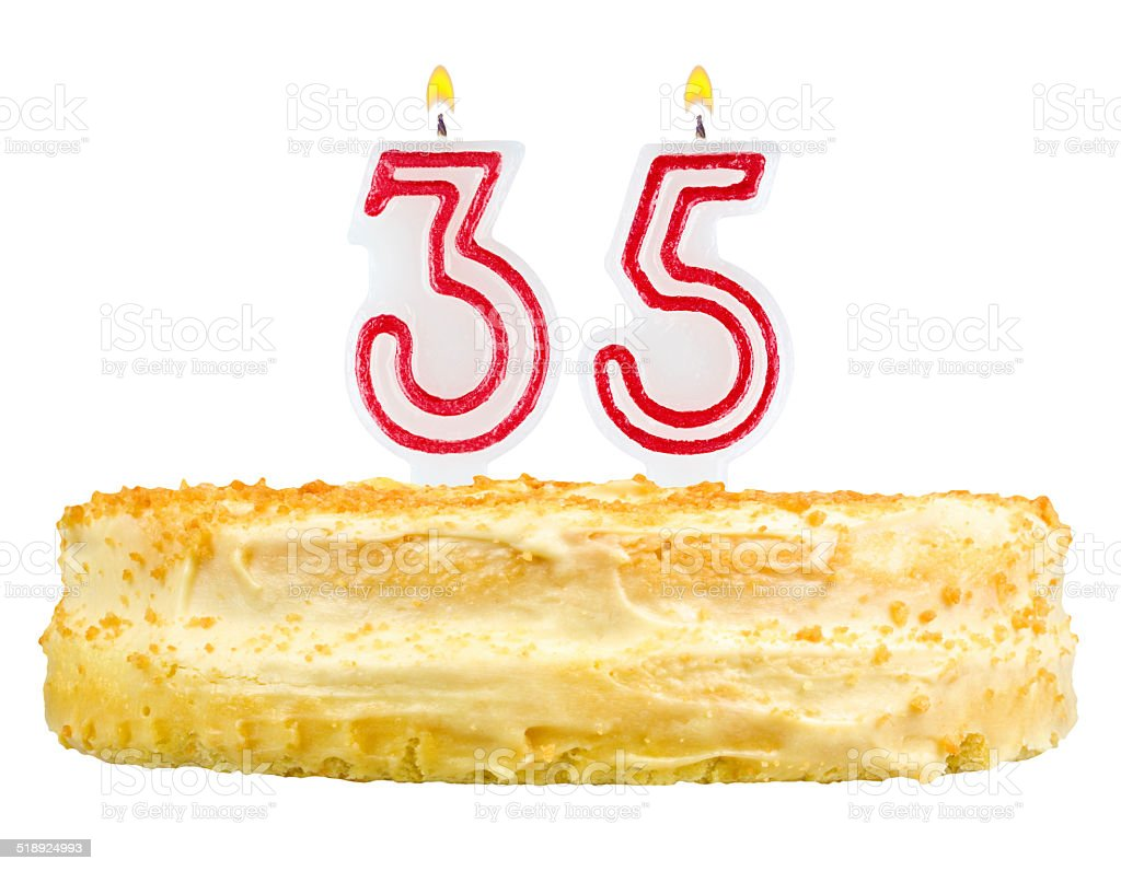 birthday cake with candles number thirty five isolated on white stock photo