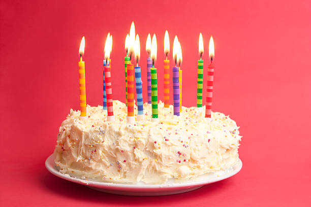 Birthday cake with candles on a red background stock photo
