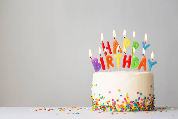 Birthday cake with colorful candles Birthday cake with colorful candles spelling happy birthday birthday cake stock pictures, royalty-free photos & images