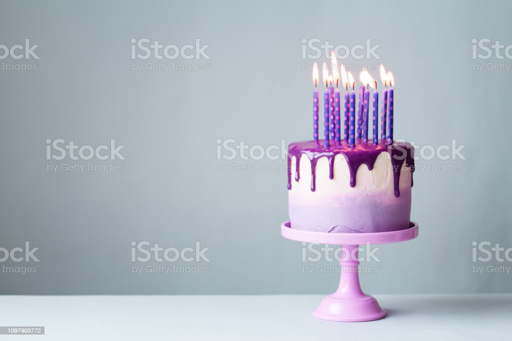 Prime Birthday Cake With Drip Icing And Purple Candles Stock Photo Personalised Birthday Cards Rectzonderlifede