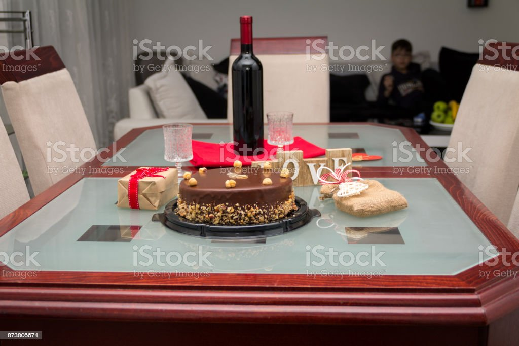 Pleasant Birthday Cake With Gifts And Wine On The Table Stock Photo Funny Birthday Cards Online Ioscodamsfinfo
