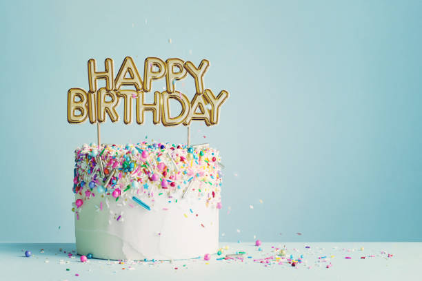Birthday cake with happy birthday banner Birthday cake with gold happy birthday banner birthday stock pictures, royalty-free photos & images