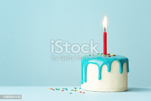 Birthday cake with drip frosting and one red candle