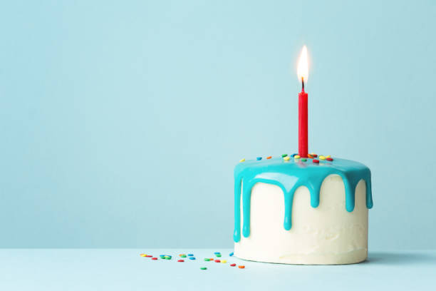 birthday cake with one red candle - single object stock pictures, royalty-free photos & images