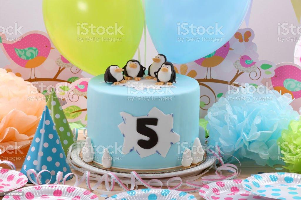 Birthday cake with penguins stock photo